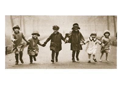 A Line of Well-Dressed Children Running in Hyde Park, from 'Wonderful London', Published 1926-27