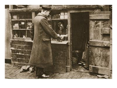 A Cobbler, Established in a Makeshift Booth in a Cobbled Mayfair Mews, Takes in Boots