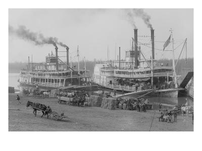 Two Steamboats Along the Levee at the Mississippi River