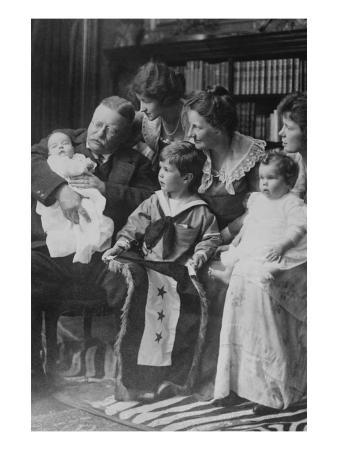 Teddy Roosevelt Holds a Baby in His Arms in a Family Portrait