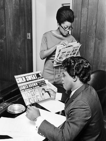 James Brown Looks over a Copy of His Record, Cold Sweat