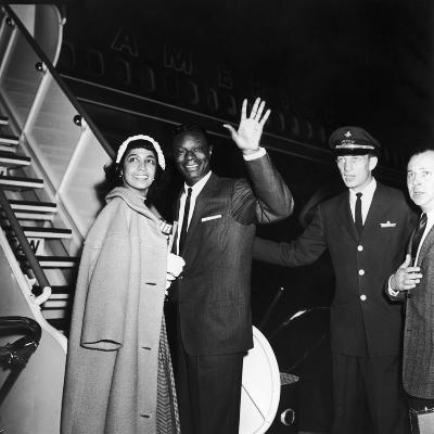 Nat King Cole and His Wife Maria Cole Wave to Bystanders, March 1959