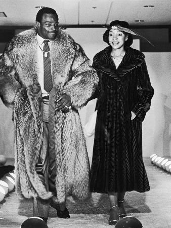 Walter and Connie Payton Model Furs in a Fashion Show Benefiting Better Boys Foundations,  1979