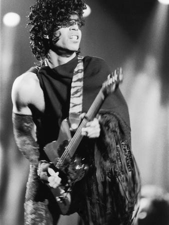 Prince, Engages the Guitar During Concert, 1984
