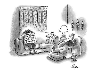 Woman holding up a cue card to her husband as he is talking on the phone t… - New Yorker Cartoon