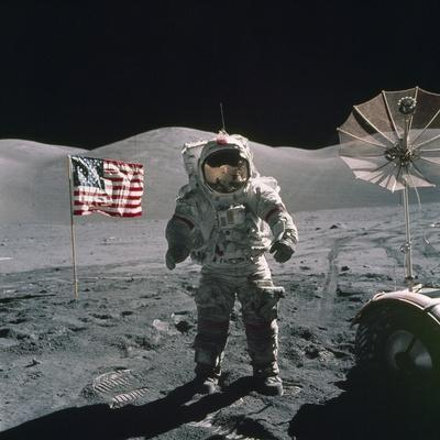 Apollo 17 Astronaut Stands Between US Flag and Lunar Rover, Dec 12, 1971