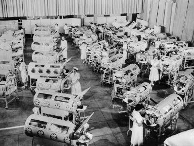 Nurse Attend to a Room Full of Polio Patients in Iron Lung Respirators