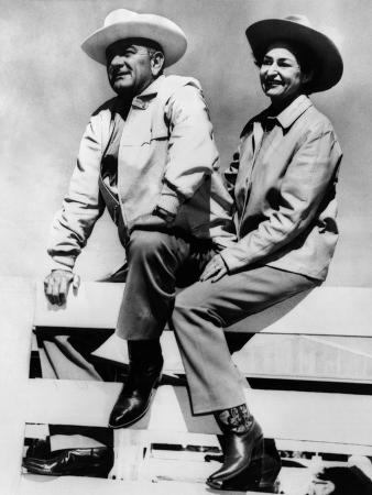 President Lyndon and Lady Bird Johnson Sitting on a Fence at the LBJ Ranch