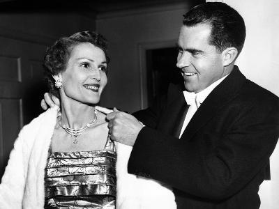 Vice President Richard Nixon Helping His Wife Pat on with a White Fur Evening Jacket, May 20, 1955