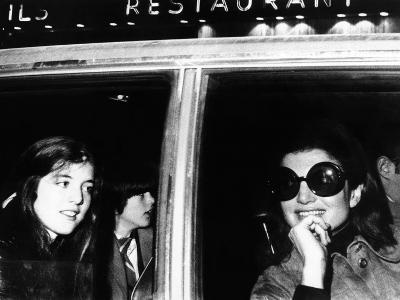 Jacqueline Kennedy Onassis in a Limousine with Her Daughter Caroline and Son John