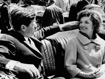 President Kennedy Tidies His Wife's Hair