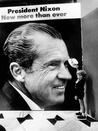 A Four-Year-Old Boy, Tips His Hat to a Huge Poster of President Nixon at the Fountainbleau Hotel