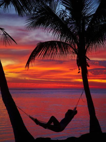 Woman In Hammock And Palm Trees At Sunset Coral Coast