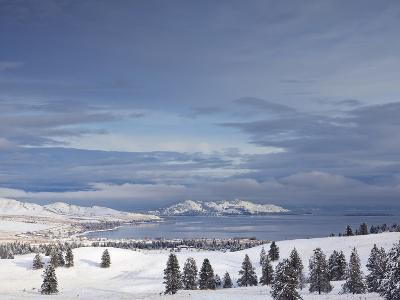 Looking Down onto Flathead Lake after Fresh Snowfall in Elmo, Montana, USA