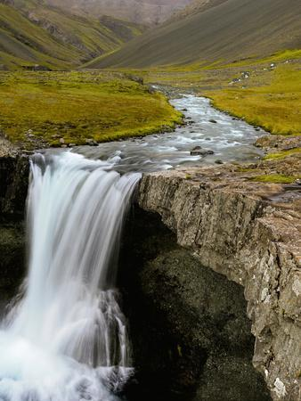 Water Running from Glacier and Waterfall, Iceland