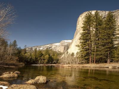 El Capitan Towers over Merced River, Yosemite, California, USA