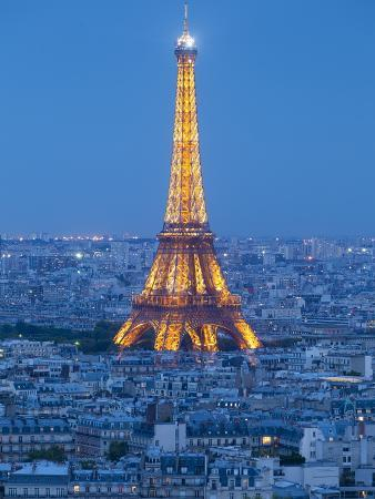 Illuminated Eiffel Tower, Viewed over Rooftops, Paris, France, Europe