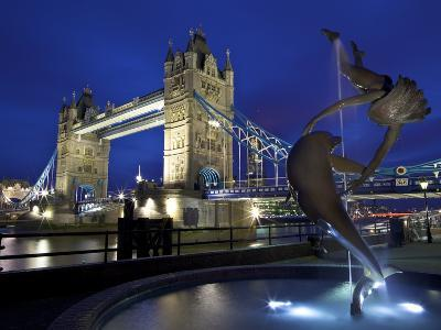 Girl with Dolphin by David Wynne, Illuminated at Night in Front of Tower Bridge, London, England