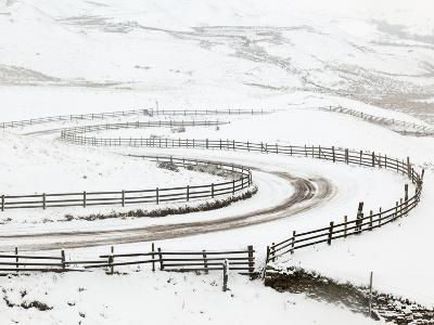 Snow on Winding Road in Edale, Peak District National Park, Derbyshire, England, UK, Europe