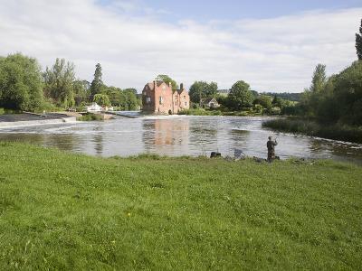 Man Fishing by Cropthorne Mill on River Avon at Fladbury, Vale of Evesham, Worcestershire, England