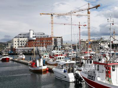 Local Fishing Boats and Cranes Working on New Library Site for North Norway, Bodo Harbour, Norway