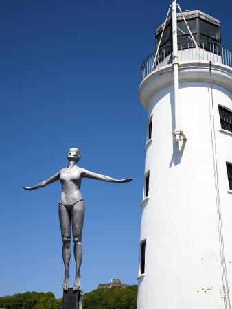 The Diving Belle Sculpture and Lighthouse on Vincents Pier, Scarborough, North Yorkshire, England