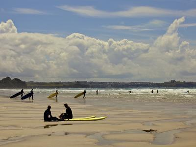 Surfers with Boards on Perranporth Beach, Cornwall, England