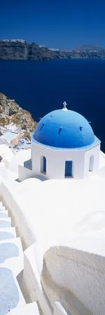 High Angle View of a Church with Blue Dome, Oia, Santorini, Cyclades Islands, Greece