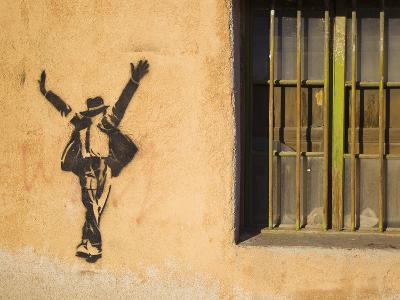 Michael Jackson Stenciled on a Wall Near a Window