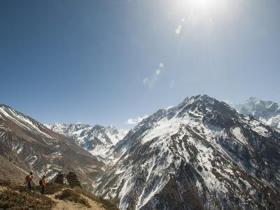 Trekkers Look Out at the Awesome View of Ganesh Himal Mountain Range