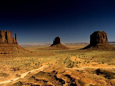 A Sun-Scorched Monument Valley in the Afternoon