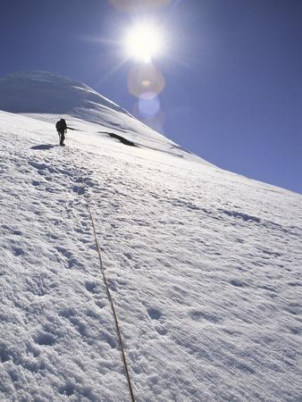 A Man Hikes Up on Mount Osorno, Chile