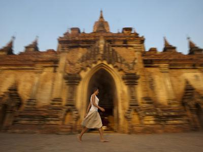 A Tourist Walks Past One of the Ancient Temples at Bagan