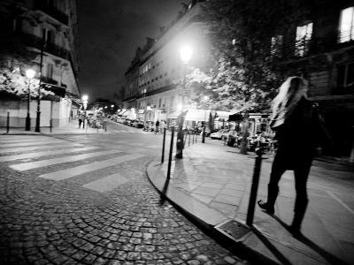 A Woman Walking at Night