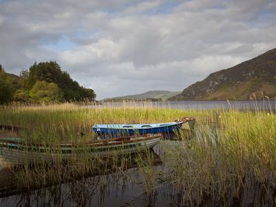 An Afternoon Landscape of a Lake with Rowboats in the Foreground