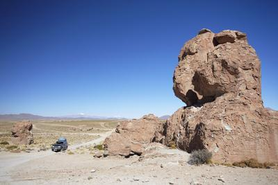Jeep Driving Through Rocky Landscape on the Altiplano, Potosi Department, Bolivia, South America