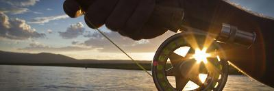 A Sunset Sunstart Through the Fly Reel of an Angler on the Henry's Fork River in Idaho.