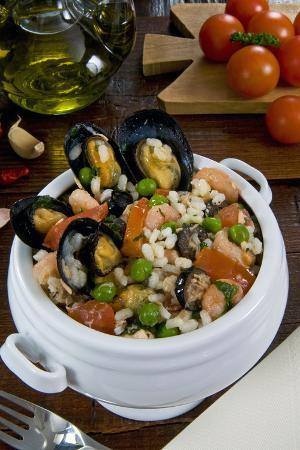 Seafood Rice with Mussels, Shrimps, Tomato, Olives, Peas, Italian Cuisine, Italy