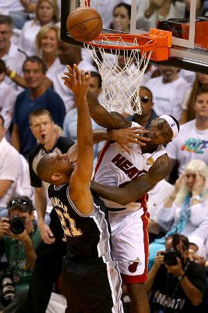 Miami, FL - JUNE 9 LeBron James and Tim Duncan