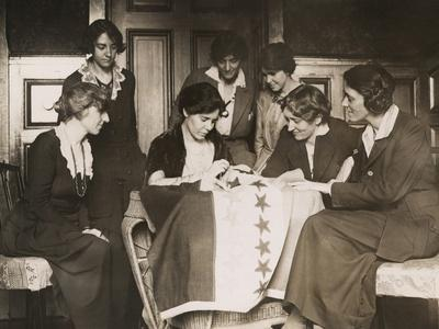 National Woman's Party's Alice Paul Sews a Star on Ratification Flag, Ca. 1919
