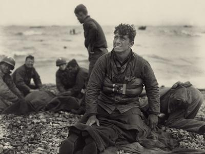 WW2 American Soldiers on Omaha Beach Recovering the Dead after the D-Day, 1944