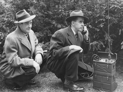 FBI Agent with an Huge Portable Phone During a Kidnapping Stakeout, Ca. 1940s