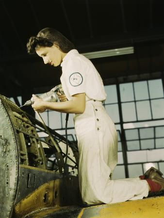 Woman Defense Worker Trainee Riveting at Naval Air Base, in Corpus Christi, 1942