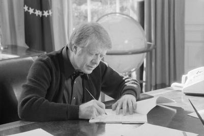 President Jimmy Carter Working at His Desk in the White House Oval Office, 1970s