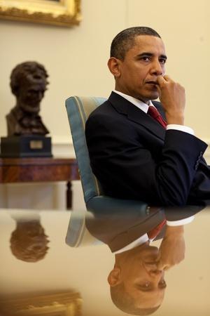 President Barack Obama Listens to His Senior Advisors During an Oval Office Meeting, Jan. 25, 2010