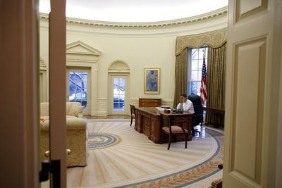 President Barack Obama Talks on the Phone in the Oval Office, Jan. 28, 2009