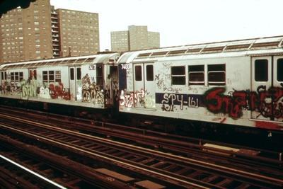 A Graffiti Painted Subway Train with Housing Projects in the Background, May 1973