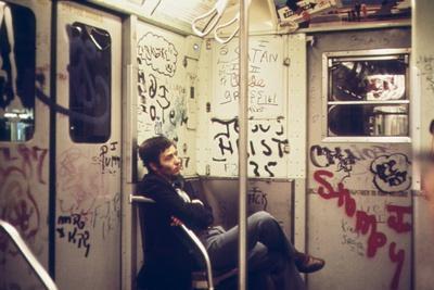 A Lone Passenger Amidst a Graffiti Painted Subway Car Interior, May 1973