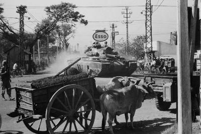 A US Army Tank Shares the Streets of Saigon, Vietnam, with Ox Carts in 1969