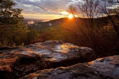 A Warm Glowing Sunset Over Mountain Ridges